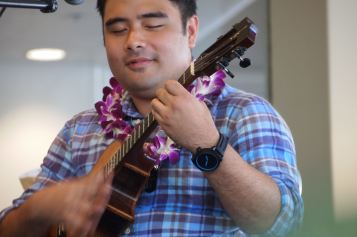 Ukists Kalei Gamiao, Benny Chong, and Byron Yasai performed at a ukulele workshop.